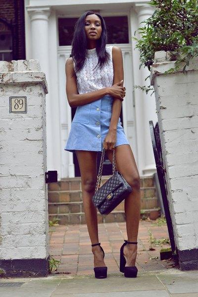 white mock neck sleeveless top with sky blue mini skater button down skirt