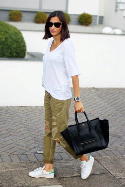 white oversized tee with green ripped khaki jeans