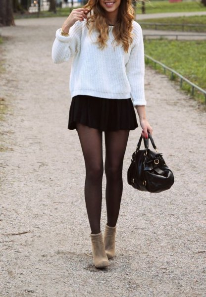 white ribbed comfy sweater with black mini skirt