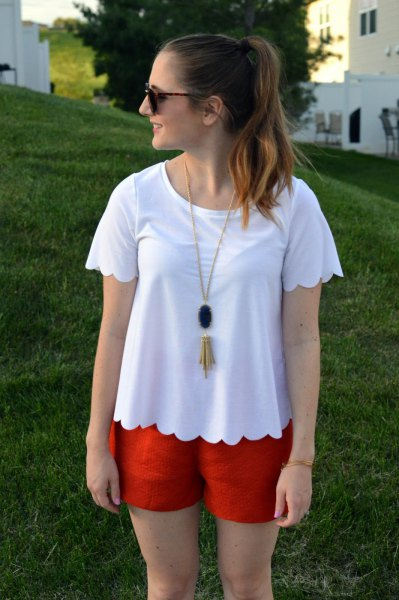 white scalloped hem t shirt with orange mini shorts