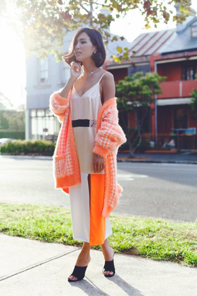 white slip maxi dress with yellow coat