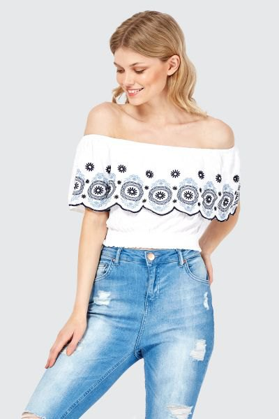 white tribal printed off the shoulder top with ripped jeans