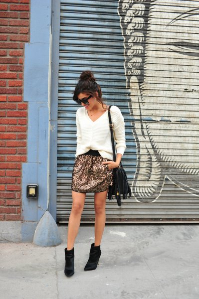 white v neck comfy sweater with sequin mini skirt and black short boots