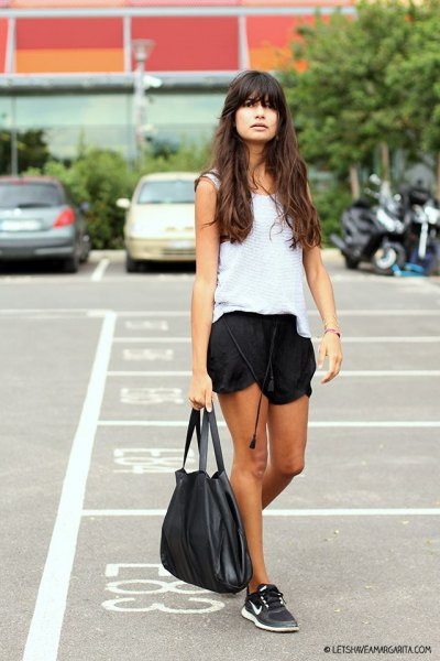 white vest top with black silk running shorts