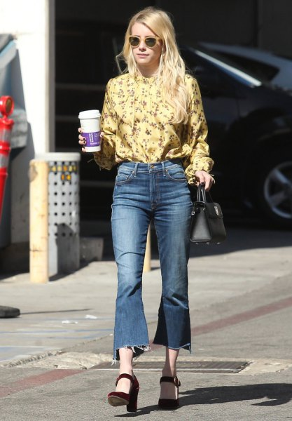 yellow floral printed blouse with flared cropped jeans