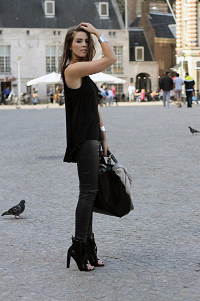 ankle boots with black relaxed fit vest top and leather leggings