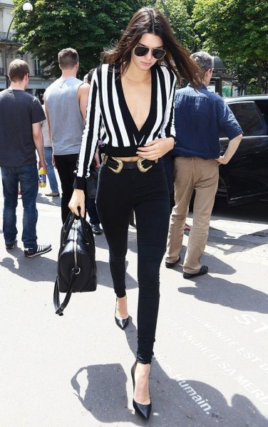 black and white deep v neck blouse with cowboy belt