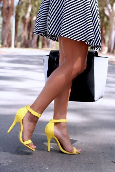 black and white diagonal striped mini fit and flare dress with yellow open toe high heels