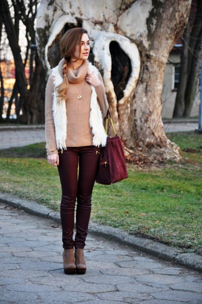 black coated jeans with blush pink turtleneck sweater and white vest