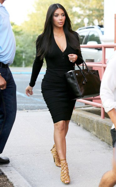 black deep v neck bodycon mini dress with bronze strappy heeled sandals