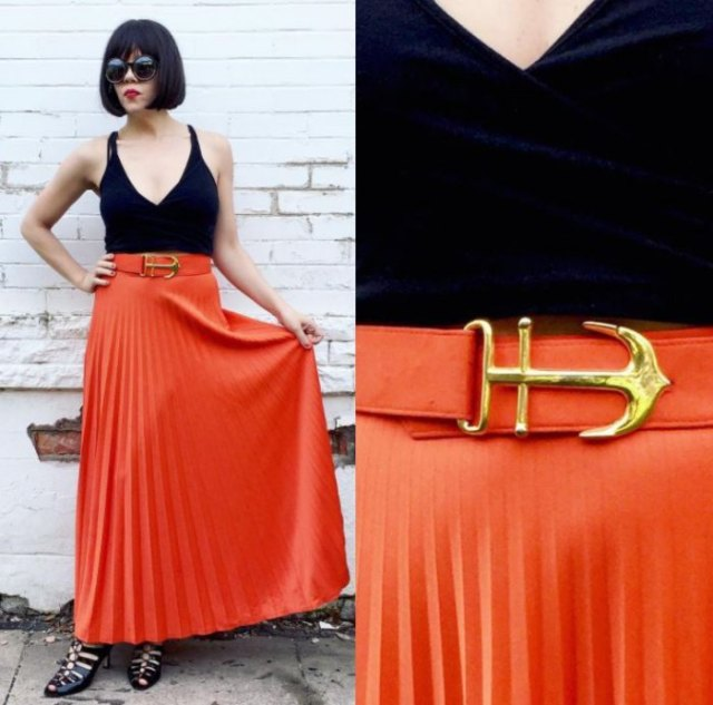 black deep v neck vest top with orange pleated maxi skirt