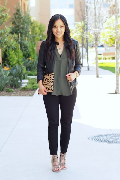black leather jacket with green chiffon v neck blouse