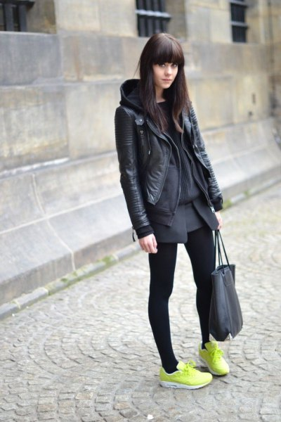 black leather jacket with grey mini skirt and yellow sneakers