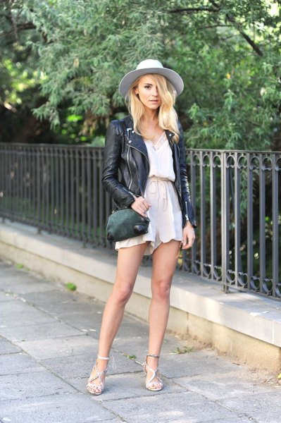 black leather jacket with white blouse and blush high rise flowy shorts