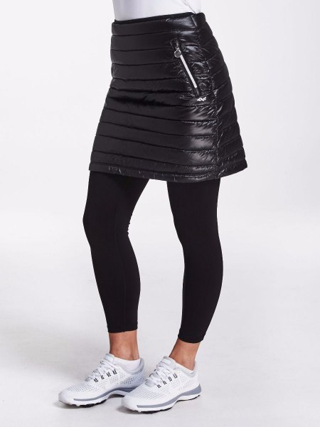 black mini down skirt with leggings and white sneakers