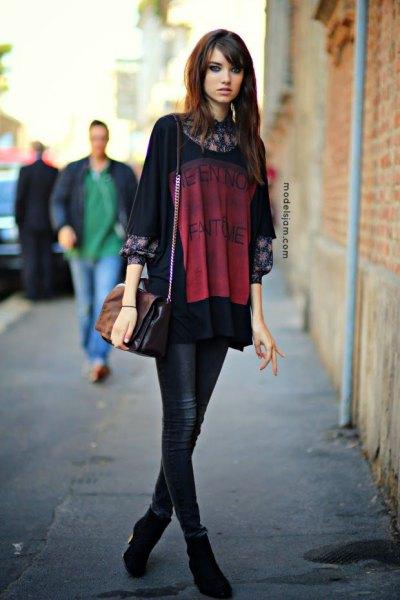 black oversized pritn t shirt over floral blouse