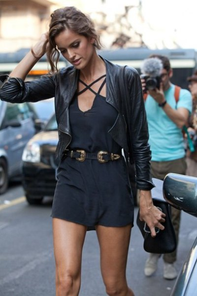 black romper with cowboy belt and leather jacket