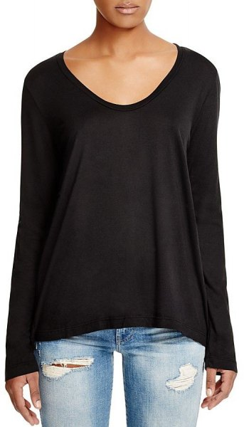 black scoop neck long sleeve tee with light blue ripped jeans