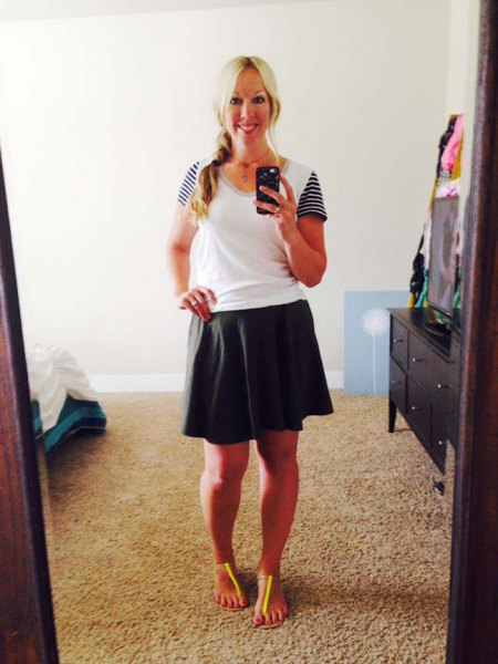 black skater skirt and white scoop neck t shirt with striped sleeves
