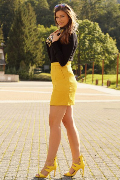 black sweater with yellow high waisted bodycon mini skirt and matching heels