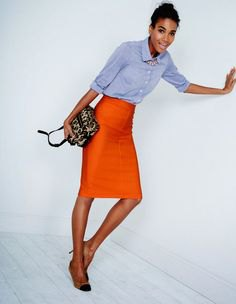 blue cuffed chambray button up shirt with midi orange skirt