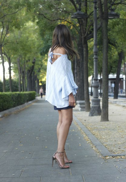 blue one shoulder blouse with black mini skirt and bronze heels