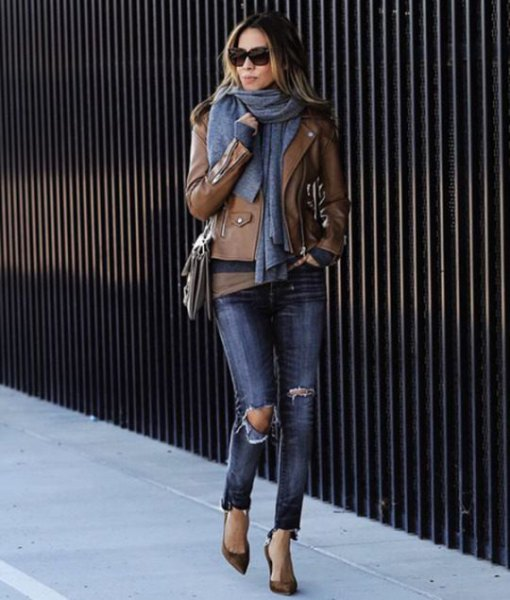 brown leather jacket with green tee and grey knit scarf