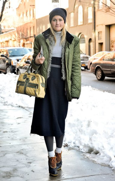 brown quilted jacket with grey and black midi shift dress and short snow boots