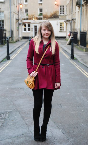 burgundy belted long coat with leggings and ankle boots
