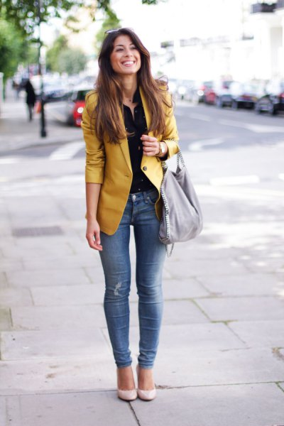 gold non shiny blazer with black blouse
