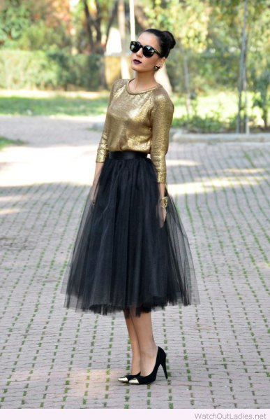 golden blouse with black midi tulle skirt