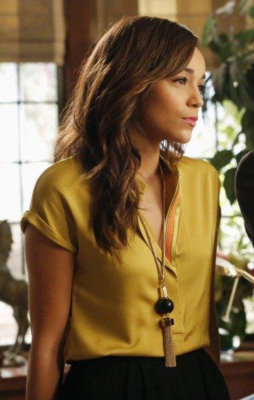 golden short sleeve button up silk blouse with black skirt