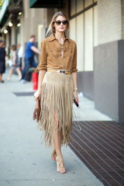 green long sleeve button up suede shirt with light grey fringe midi skirt