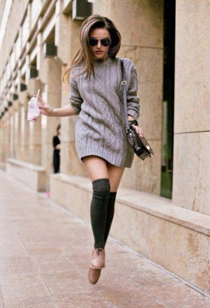 grey cable knit sweater dress with black thigh high socks
