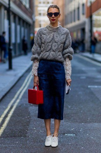 grey chunky sweater with navy midi skirt and white leather shoes