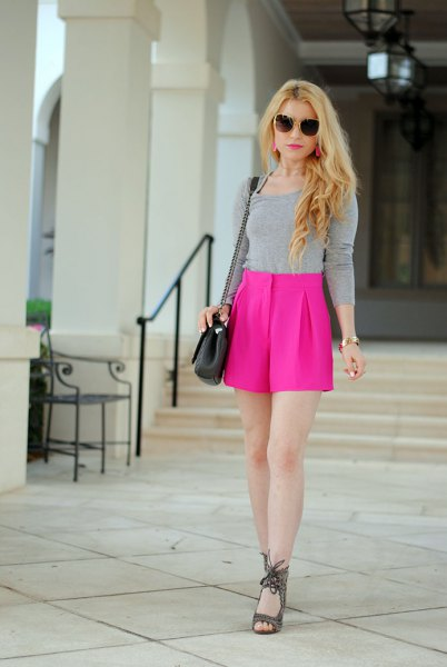 grey form fitting long sleeve tee with high waisted pink flowy shorts
