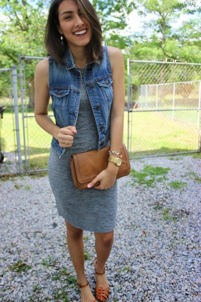 grey knee length sleeveless dress with blue denim vest