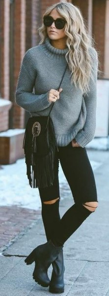 grey mock neck chunky knit sweater with black ripped skinny jeans