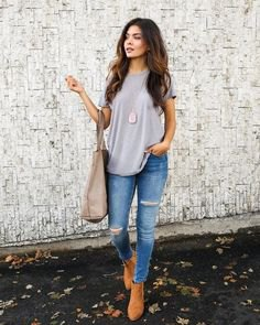 grey oversized t shirt with light blue skinny jeans and camel boots