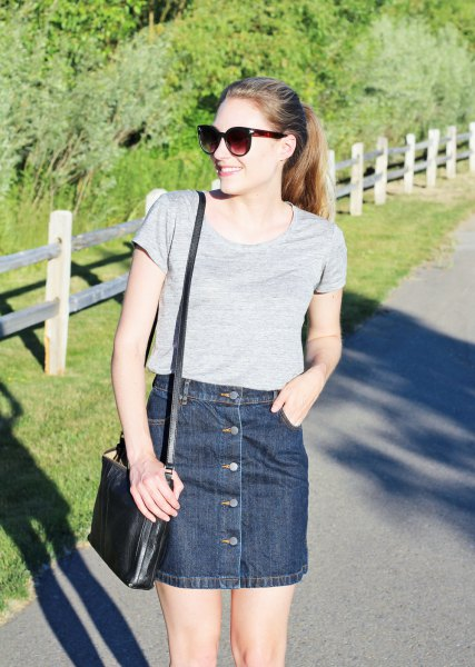 grey scoop neck t shirt with dark blue button front denim mini skirt