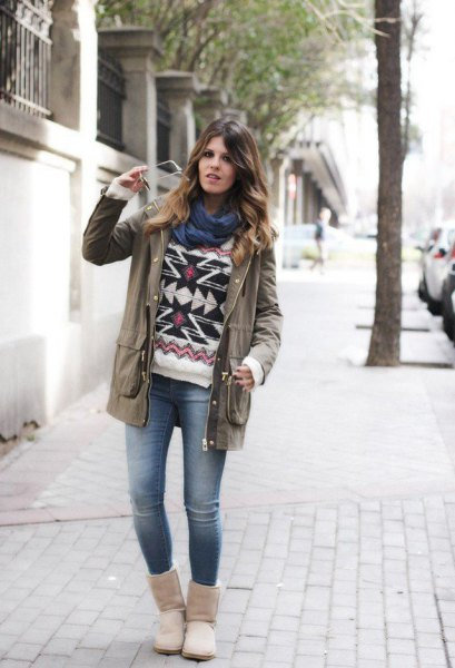 grey trench coat with tribal printed sweater and snow boots
