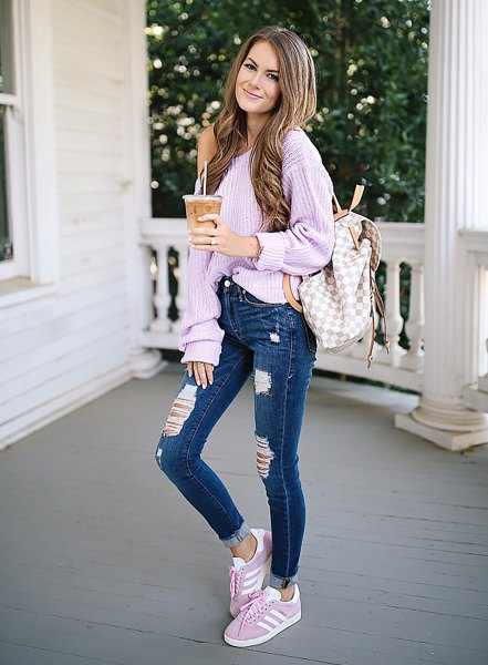 lavender one shoulder chunky ribbed sweater with blue jeans