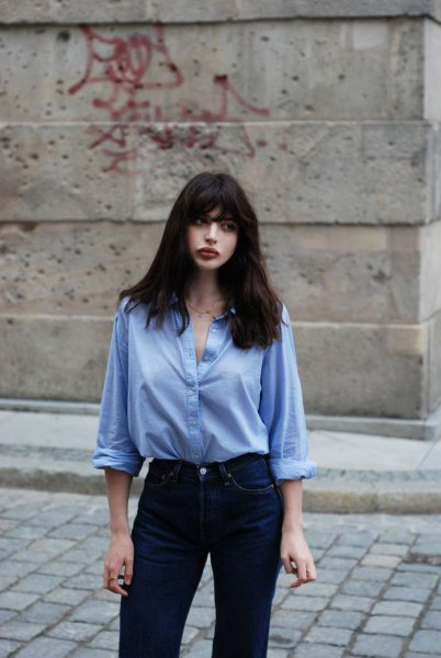 light blue button up shirt with slim cut jeans