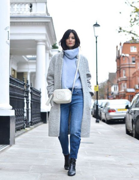 light blue cowl neck sweater with grey wool coat and jeans