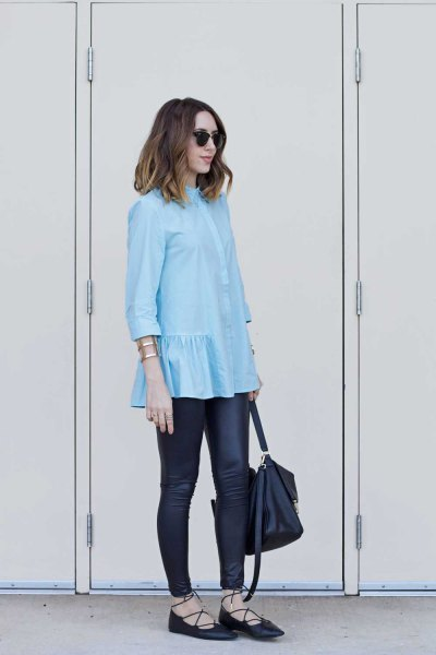 light blue ruffle hem blouse with black leather leggings