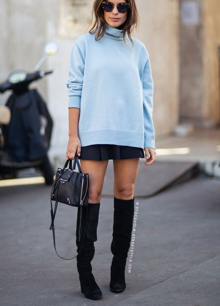 light blue turtleneck chunky sweater with black mini skirt and boots