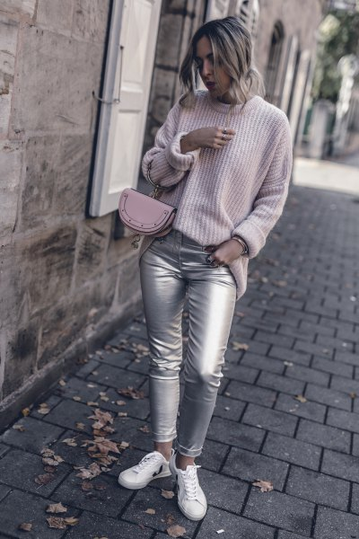 light grey ribbed crew neck sweater with silver skinny jeans