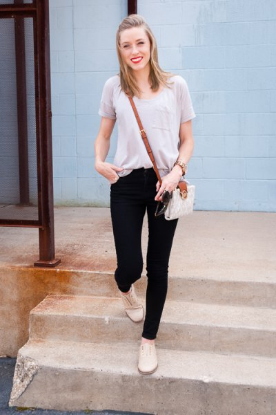 light grey scoop neck tee with black skinny jeans and pale yellow boots