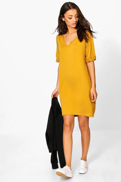 mustard yellow v neck t shirt dress with white sneakers