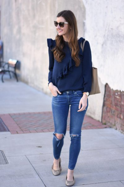 navy blue long sleeve top with blue ripped skinny jeans